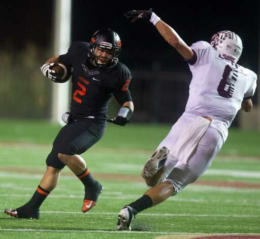 Refugio running back Draigon Silvas (2) avoids East Bernard linebacker Trevor Long (8). Photo: J. Patric Schneider, For The Chronicle / © 2012 Houston Chronicle