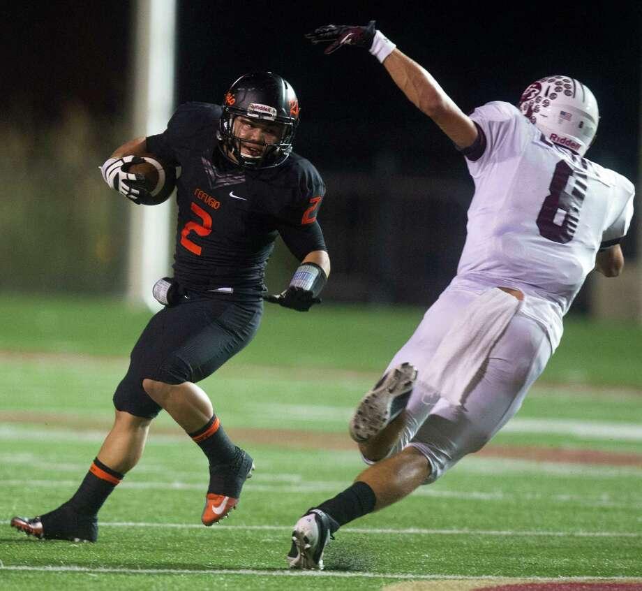 Refugio running back Draigon Silvas (2) avoids East Bernard linebacker Trevor Long (8). Photo: J. Patric Schneider, For The Chronicle / © 2012 Houston Chronicle