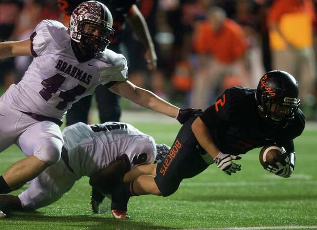 Refugio running back Draigon Silvas (2) is tackled by East Bernard linebacker Zach Stavinoha (44) and defensive back Victor Pettit (9). Photo: J. Patric Schneider, For The Chronicle / © 2012 Houston Chronicle