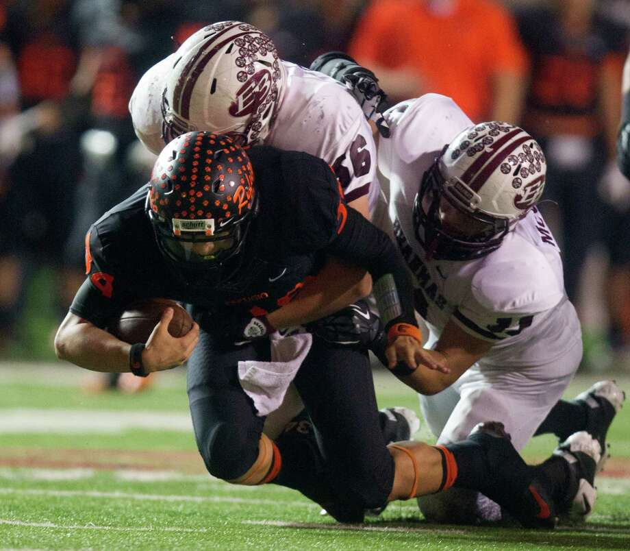 East Bernard 54, Refugio 23Refugio quarterback Travis Quintanilla (34) is brought down by East Bernard defensive ends Jordan Darr (56) and Justin McGuire (11). Photo: J. Patric Schneider, For The Chronicle / © 2012 Houston Chronicle