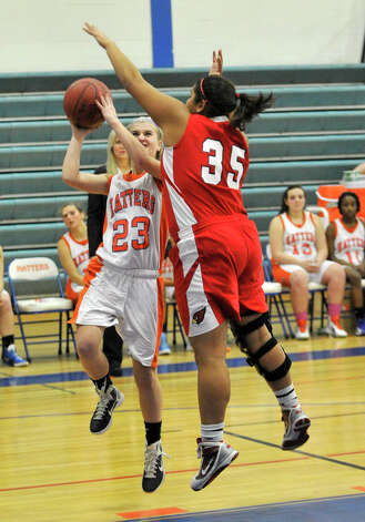 Danbury's Lindsey Eanniello shoots a layup while under pressure from Greenwich's Brittany Rodriguez during their game at Danbury High School on Friday, Dec. 7, 2012. Danbury won, 54-34. Photo: Jason Rearick / The News-Times