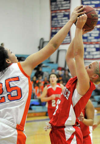 Danbury's Kayla Handberry blocks the shot of Greenwich's Rebecca DeCarlo during their game at Danbury High School on Friday, Dec. 7, 2012. Danbury won, 54-34. Photo: Jason Rearick / The News-Times