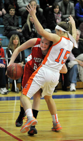 Greenwich's Abbie Wolf goes baseline on Danbury's Rebecca Gartner during their game at Danbury High School on Friday, Dec. 7, 2012. Danbury won, 54-34. Photo: Jason Rearick / The News-Times