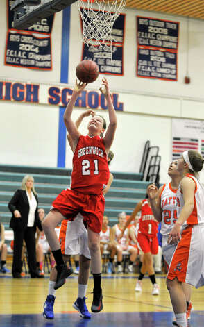 Greenwich's Abbie Wolf attempts a layup during their game against Danbury at Danbury High School on Friday, Dec. 7, 2012. Danbury won, 54-34. Photo: Jason Rearick / The News-Times