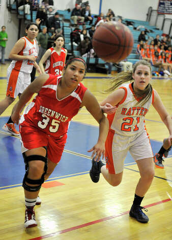 Greenwich's Brittany Rodriguez and Danbury's Kaitlin Aldridge compete for the loose ball during their game at Danbury High School on Friday, Dec. 7, 2012. Danbury won, 54-34. Photo: Jason Rearick / The News-Times
