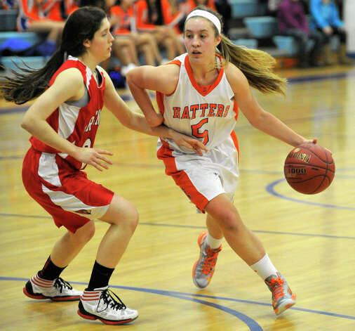 Danbury's Rachel Gartner dribbles around Greenwich's Leigh Galletta during their game at Danbury High School on Friday, Dec. 7, 2012. Danbury won, 54-34. Photo: Jason Rearick / The News-Times