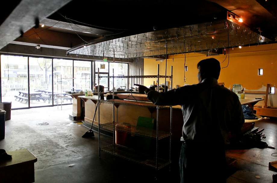 "Dave Rowe, a former manager of the popular Bear's Lair pub on campus that now is closed down, works on clearing out the site. ""The place was a blast,"" Rowe recalls. Photo: Michael Macor, The Chronicle"