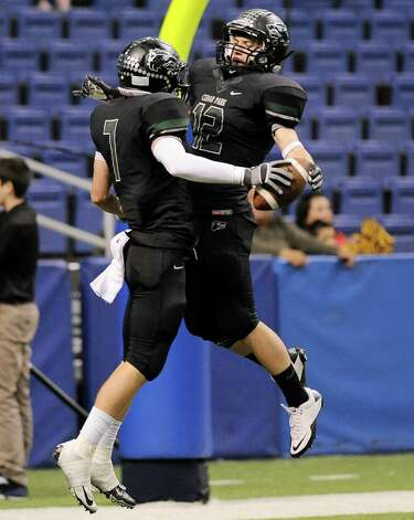 Cedar Park's Ethan Fry, left, and Stoney Schoenfeld celebrate a touchdown during a 4A high school football playoff game against Brennan, Friday, Dec. 7, 2012, at the Alamodome in San Antonio. Cedar Park won 32-7. Photo: Darren Abate, For The Express-News