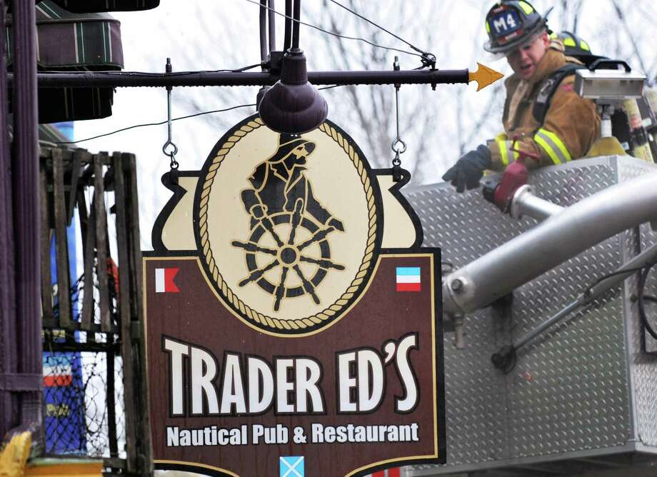 Troy firefighters battle a blaze in the historic building that housed Trader Ed's Pub on 2nd Ave. in Troy  Wednesday Oct. 26, 2011.  (John Carl D'Annibale / Times Union) Photo: John Carl D'Annibale