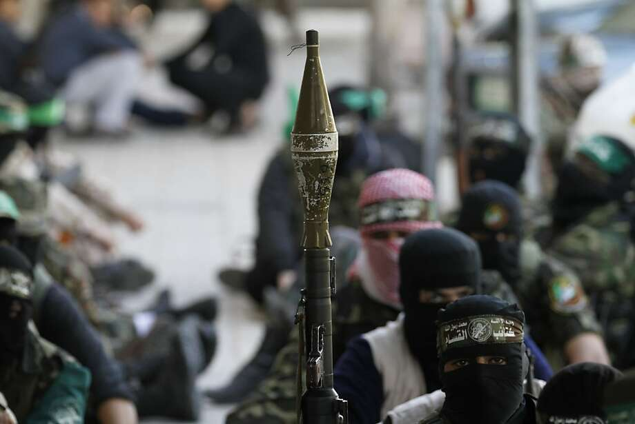 Palestinian militants of the Ezzedine al-Qassam brigade, the armed wing Hamas, attend Friday prayer as they prepare for the arrival of the Islamist movement's exiled politburo chief Khaled Meshaal who is due in the Gaza Strip to celebrate its 25th anniversary on December 7, 2012. Photo: Mohammed Abed, AFP/Getty Images