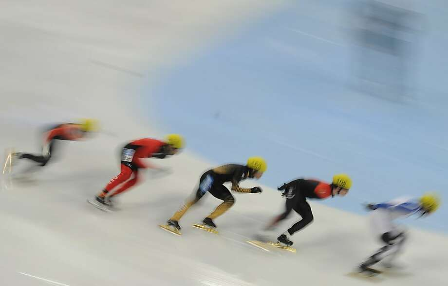 Skaters compete in the men's 1000m heats in the Samsung ISU World Cup Short Track Speed Skating event in Shanghai on December 7, 2012. Photo: Peter Parks, AFP/Getty Images