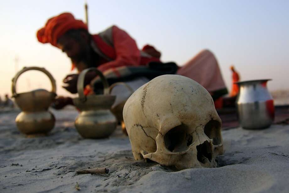 A human skull is pictured as a Hindu holy man prepares for a ritual after his arrival at Sangam to participate in the upcoming Maha Kumbh Festival, in Allahabad on December 7, 2012. The Kumbh Mela is the largest gathering of people for a religious purpose in the world and millions of people gather for this auspicious occasion. Photo: Sanjay Kanojia, AFP/Getty Images