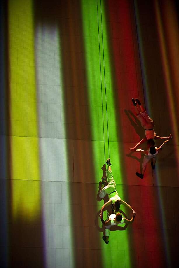 Members of the Company aerial dance Brenda Angiel of Argentina perform over a wall as part of Christmas season on December 7, 2012 in Medellin, Antioquia department, Colombia. Photo: Raul Arboleda, AFP/Getty Images