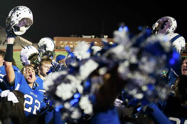 Navasota's Anthony Small (22) celebrates with the team cheerleaders after the victory over West Orange-Stark. Photo: Smiley N. Pool, Houston Chronicle / © 2012  Houston Chronicle