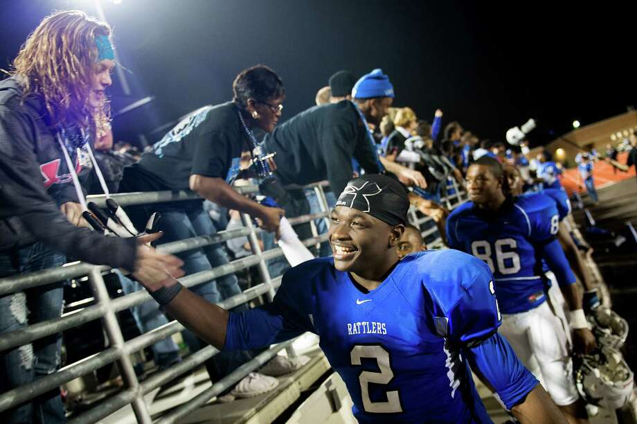 Navasota's Austin Collins (2) celebrates with fans after the victory over West Orange-Stark. Collins scored four touchdowns in the game. Photo: Smiley N. Pool, Houston Chronicle / © 2012  Houston Chronicle
