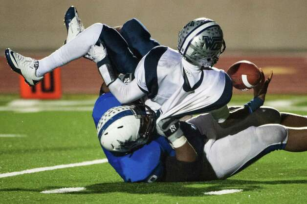 West Orange-Stark quarterback Jimmy Salter (8) tries to hold on to the ball as he is sacked by Navasota's Jordan Wells (68). Photo: Smiley N. Pool, Houston Chronicle / © 2012  Houston Chronicle