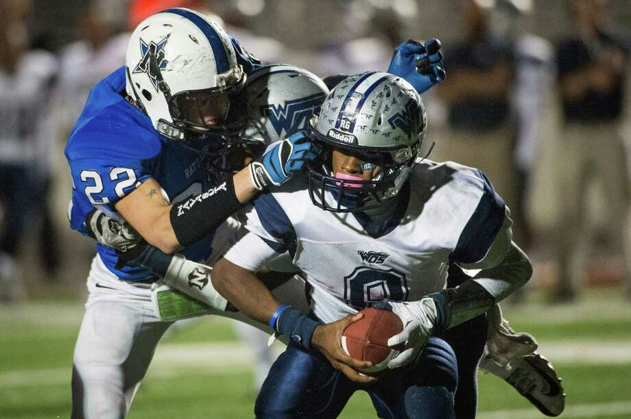 Navasota 38, West Orange-Stark 7Navasota's Anthony Small (22) grabs the face mask of West Orange-Stark quarterback Jimmy Salter (8) during the fourth quarter. Photo: Smiley N. Pool, Houston Chronicle / © 2012  Houston Chronicle
