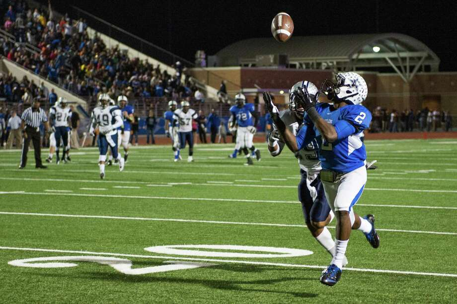 Navasota's Austin Collins (2) hauls in a 46-yard touchdown pass as West Orange-Stark's Quentin Tezeno (29) defends during the first quarter of a Class 3A Division II Region III high school football playoff game at Turner Stadium, Friday, Dec. 7, 2012, in Humble. ( Smiley N. Pool / Houston Chronicle ) Photo: Smiley N. Pool, Staff / © 2012  Houston Chronicle