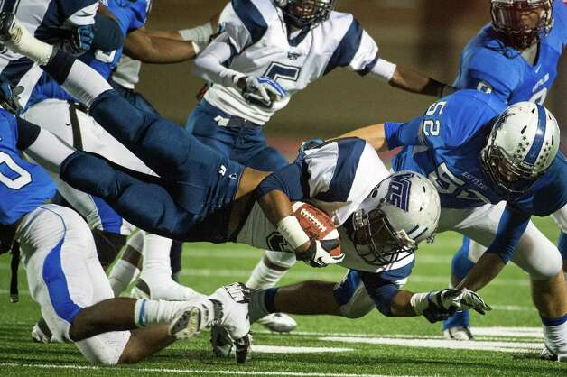 West Orange-Stark running back  Abear Simien (35) is brought down by Navasota's Dustin Savensky (52) during the first quarter of a Class 3A Division II Region III high school football playoff game at Turner Stadium, Friday, Dec. 7, 2012, in Humble. ( Smiley N. Pool / Houston Chronicle ) Photo: Smiley N. Pool, Staff / © 2012  Houston Chronicle