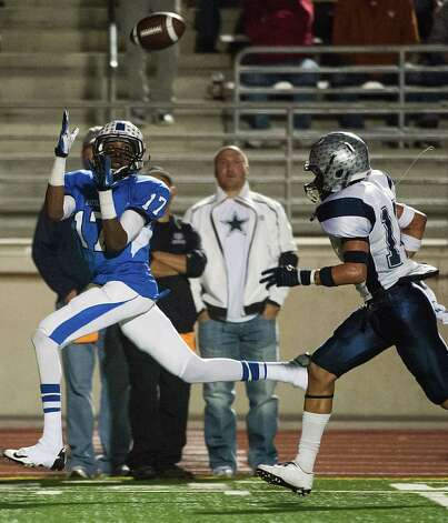 Navasota's Terrance Creeks (17) hauls in a long touchdown pass as West Orange-Stark's J'Marcus Rhodes (14) defends during the first quarter of a Class 3A Division II Region III high school football playoff game at Turner Stadium, Friday, Dec. 7, 2012, in Humble. ( Smiley N. Pool / Houston Chronicle ) Photo: Smiley N. Pool, Staff / © 2012  Houston Chronicle