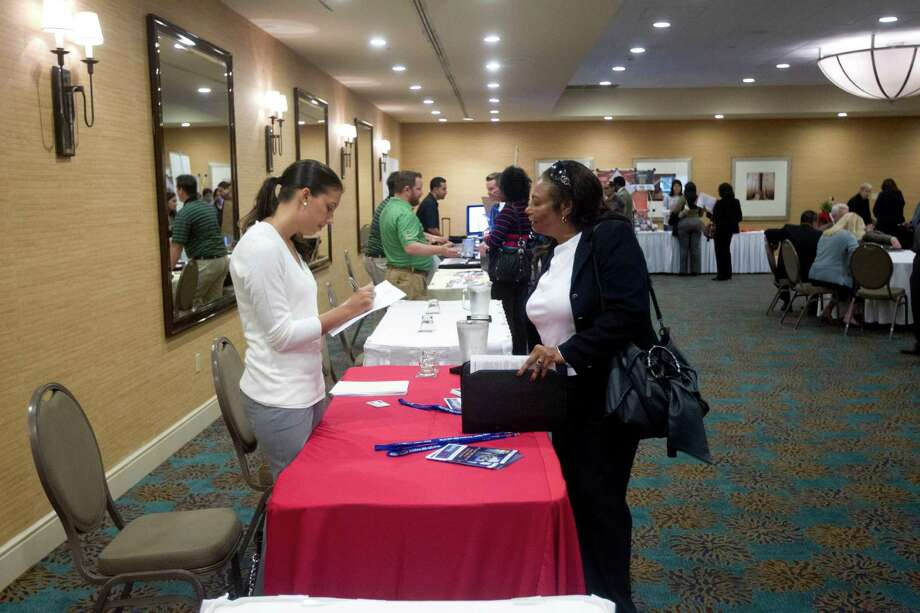 In this Friday, Nov. 30, 2012 photo, a person fills out an application at the Fort Lauderdale Career Fair, in Dania Beach, Fla. The U.S. economy added a solid 146,000 jobs in November and the unemployment rate fell to 7.7 percent, the lowest since December 2008, the Labor Department announced Friday, Dec. 7, 2012. The government said Superstorm Sandy had only a minimal effect on the figures. (AP Photo/J Pat Carter) Photo: J Pat Carter