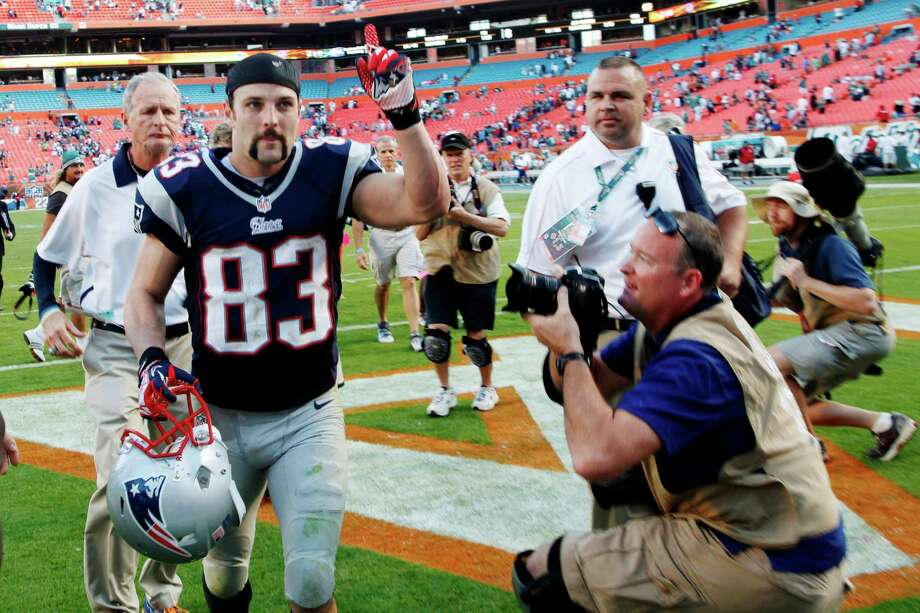 New England Patriots wide receiver Wes Welker (83) gestures to fans as he leaves the field after their 23-16 win in an NFL football game, Sunday, Dec. 2, 2012, in Miami. Welker tied Jerry Rice's NFL record by making at least 10 receptions for the 17th time. He had 12 catches for 103 yards and a score. (AP Photo/Wilfredo Lee) Photo: Wilfredo Lee
