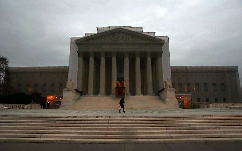 The U.S. Supreme Court building is draped in a photo-realistic sheet during a repair and preservation project December 7, 2012, 2012 in Washington, DC. The Supreme Court announced on Friday that it will take up cases on whether same-sex marriage should be banned in California and whether legally married gay couples can get the same federal benefits as heterosexual couples. Photo: Alex Wong, Getty Images