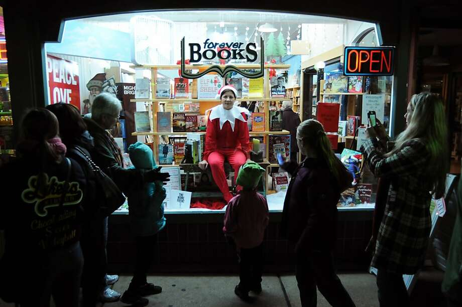 Diana Koehler poses in the window of Forever Books, in downtown St. Joseph, Mich., as part of the Live Mannequin displays Friday, Dec. 7, 2012. Dozens of businesses and nearly 100 models participated in the inaugural event which helped welcome in the holiday season. Photo: Don Campbell, Associated Press