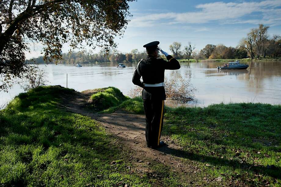 Bugler Baldwin Wong salutes as a wreath is placed into the Sacramento River during a Pearl Harbor remembrance ceremony at Discovery Park in Sacramento, Calif. on Friday, December 7, 2012. The officers and members of the USS Holland SS-1 Gold Country Base, United States Submarine Veterans, for the 26th consecutive year conducted a Pearl Harbor Remembrance and Wreath Laying Ceremony. Photo: Randall Benton, Associated Press