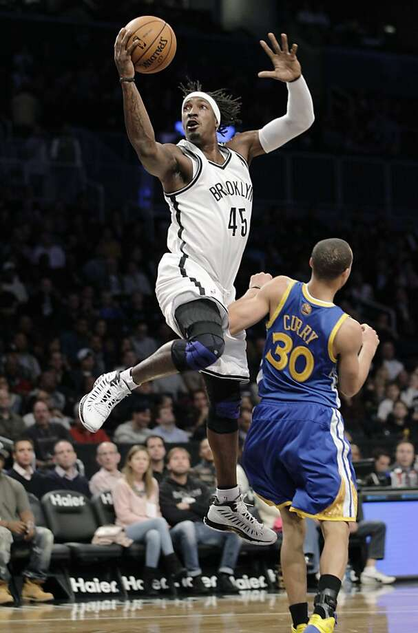 Brooklyn Nets forward Gerald Wallace (45) collides with Golden State Warriors guard Stephen Curry (30) as he goes up for a layup in the first half of an NBA basketball game at the Barclays Center, Friday, Dec. 7, 2012, in New York. (AP Photo/Kathy Willens) Photo: Kathy Willens, Associated Press