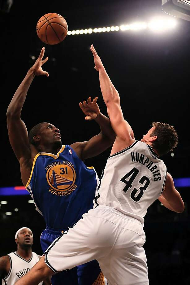 NEW YORK, NY - DECEMBER 07:  Festus Ezeli #31 of the Golden State Warriors takes a shot as Kris Humphries #43 of the Brooklyn Nets defends on December 7, 2012 at the Barclays Center in the Brooklyn borough of New York City.  NOTE TO USER: User expressly acknowledges and agrees that, by downloading and/or using this photograph, user is consenting to the terms and conditions of the Getty Images License Agreement.  (Photo by Elsa/Getty Images) Photo: Elsa, Getty Images