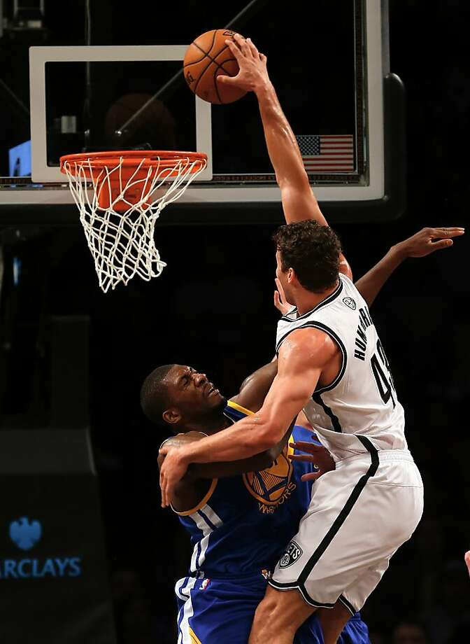 NEW YORK, NY - DECEMBER 07:  Festus Ezeli #31 of the Golden State Warriors tries to block a dunk by Kris Humphries #43 of the Brooklyn Nets defends on December 7, 2012 at the Barclays Center in the Brooklyn borough of New York City.  NOTE TO USER: User expressly acknowledges and agrees that, by downloading and/or using this photograph, user is consenting to the terms and conditions of the Getty Images License Agreement.  (Photo by Elsa/Getty Images) Photo: Elsa, Getty Images