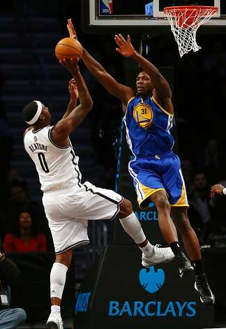 NEW YORK, NY - DECEMBER 07:  Festus Ezeli #31 of the Golden State Warriors tries to block a shot by Andray Blatche #0 of the Brooklyn Nets on December 7, 2012 at the Barclays Center in the Brooklyn borough of New York City.  NOTE TO USER: User expressly acknowledges and agrees that, by downloading and/or using this photograph, user is consenting to the terms and conditions of the Getty Images License Agreement.  (Photo by Elsa/Getty Images) Photo: Elsa, Getty Images