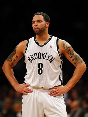 NEW YORK, NY - DECEMBER 07:  Deron Williams #8 of the Brooklyn Nets looks in the first half against the Golden State Warriors on December 7, 2012 at the Barclays Center in the Brooklyn borough of New York City.  NOTE TO USER: User expressly acknowledges and agrees that, by downloading and/or using this photograph, user is consenting to the terms and conditions of the Getty Images License Agreement.  (Photo by Elsa/Getty Images) Photo: Elsa, Getty Images