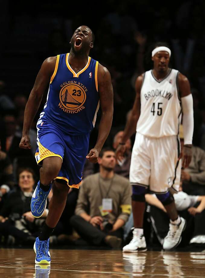 NEW YORK, NY - DECEMBER 07:  Draymond Green #23 of the Golden State Warriors celebrates in the final minute of the game as Gerald Wallace #45 lof the Brooklyn Nets stands by on December 7, 2012 at the Barclays Center in the Brooklyn borough of New York City. The Golden State Warriors defeated the Brooklyn Nets 109-102. NOTE TO USER: User expressly acknowledges and agrees that, by downloading and/or using this photograph, user is consenting to the terms and conditions of the Getty Images License Agreement.  (Photo by Elsa/Getty Images) Photo: Elsa, Getty Images