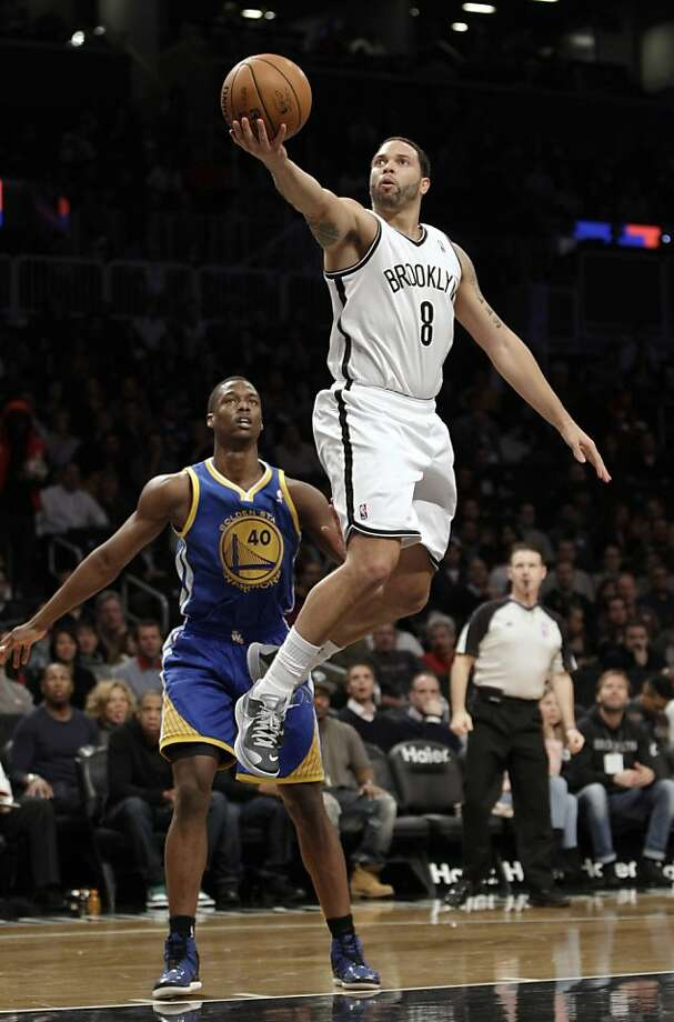 Golden State Warriors forward Harrison Barnes (40) watches from the floor as Brooklyn Nets guard Deron Williams (8) goes up for a layup in the first half of an NBA basketball game at Barclays Center, Friday, Dec. 7, 2012, in New York. (AP Photo/Kathy Willens) Photo: Kathy Willens, Associated Press
