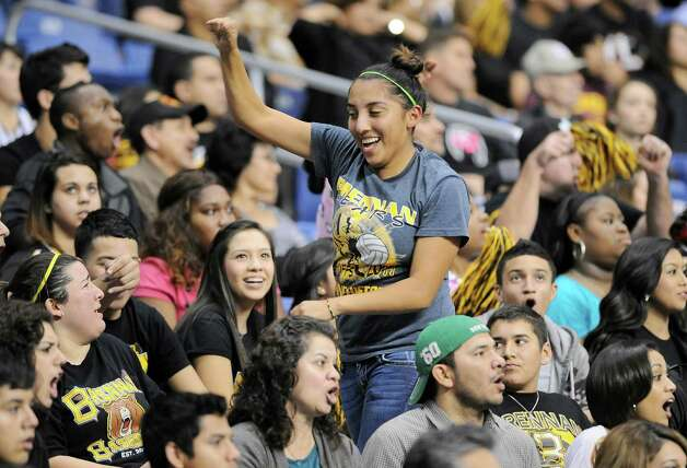 A Brennan fan dances in the bleachers during a 4A high school football playoff game against Cedar Park, Friday, Dec. 7, 2012, at the Alamodome in San Antonio. Cedar Park won 32-7. Photo: Darren Abate, For The Express-News