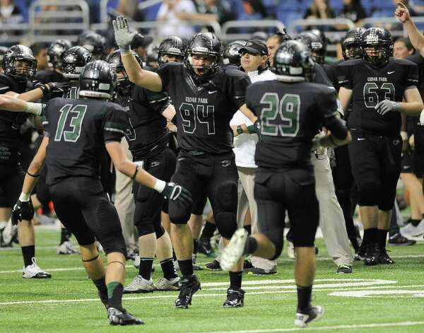 Cedar Park players celebrate after a 4A high school football playoff game against Brennan, Friday, Dec. 7, 2012, at the Alamodome in San Antonio. Cedar Park won 32-7. Photo: Darren Abate, For The Express-News