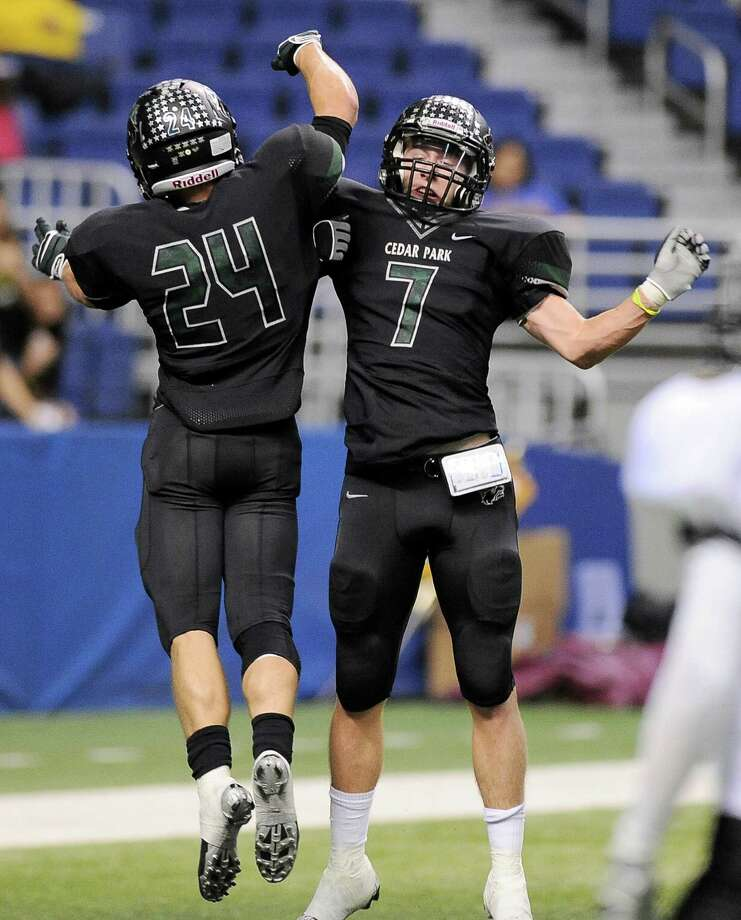 Cedar Park's Ethan Fry (7) and Nathan Harwell celebrate a touchdown during the first half of a 4A high school football playoff game, Friday, Dec. 7, 2012, at the Alamodome in San Antonio. Photo: Darren Abate, For The Express-News