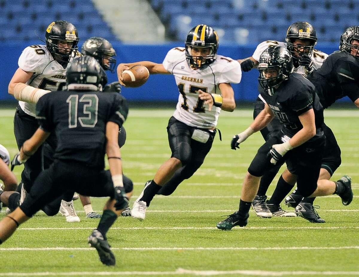 Brennan quarterback Da'shawn Key (17) runs through Cedar Park defenders during a 4A high school football playoff game, Friday, Dec. 7, 2012, at the Alamodome in San Antonio. Cedar Park won 32-7.