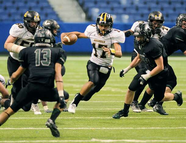 Brennan quarterback Da'shawn Key (17) runs through Cedar Park defenders during a 4A high school football playoff game, Friday, Dec. 7, 2012, at the Alamodome in San Antonio. Cedar Park won 32-7. Photo: Darren Abate, For The Express-News