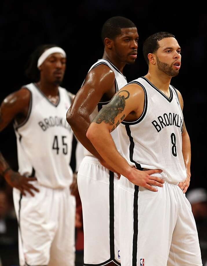 NEW YORK, NY - DECEMBER 07:  Deron Williams #8,Joe Johnson #7 an Gerald Wallace #45 of the Brooklyn Nets look on during a play review in the fourth quarter against the Golden State Warriors on December 7, 2012 at the Barclays Center in the Brooklyn borough of New York City. The Golden State Warriors defeated the Brooklyn Nets 109-102. NOTE TO USER: User expressly acknowledges and agrees that, by downloading and/or using this photograph, user is consenting to the terms and conditions of the Getty Images License Agreement.  (Photo by Elsa/Getty Images) Photo: Elsa, Getty Images