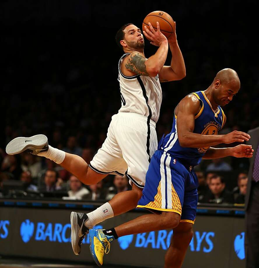 NEW YORK, NY - DECEMBER 07:  Deron Williams #8 of the Brooklyn Nets tries to take a shot as he and Jarrett Jack #2 of the Golden State Warriors collide on December 7, 2012 at the Barclays Center in the Brooklyn borough of New York City. The Golden State Warriors defeated the Brooklyn Nets 109-102. NOTE TO USER: User expressly acknowledges and agrees that, by downloading and/or using this photograph, user is consenting to the terms and conditions of the Getty Images License Agreement.  (Photo by Elsa/Getty Images) Photo: Elsa, Getty Images