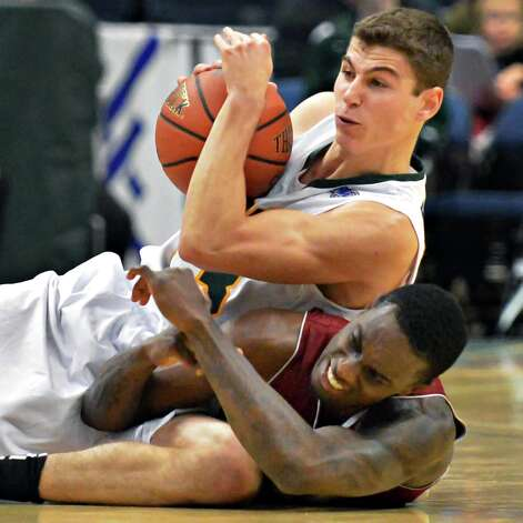 Siena's #33 Rob Poole, top, beats Rider's #10 Anthony Miles to a loose ball during the Metro Atlantic Athletic Conference opener at the Times Union Center in Albany Friday Dec. 7, 2012.  (John Carl D'Annibale / Times Union) Photo: John Carl D'Annibale / 00020381A