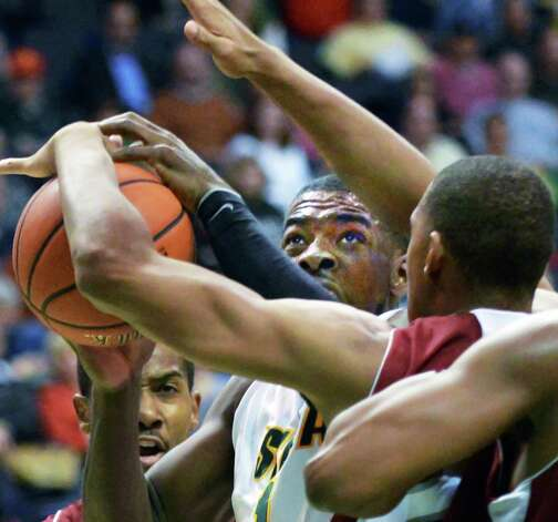 Siena's #1 O.D.Anosike, center, is fouled on his way to the basket during the Metro Atlantic Athletic Conference opener against Rider at the Times Union Center in Albany Friday Dec. 7, 2012.  (John Carl D'Annibale / Times Union) Photo: John Carl D'Annibale / 00020381A