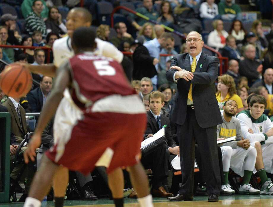 Siena head coach Mitch Buonaguro, at right, calls out to his players during the Metro Atlantic Athletic Conference opener against Rider at the Times Union Center in Albany Friday Dec. 7, 2012.  (John Carl D'Annibale / Times Union) Photo: John Carl D'Annibale / 00020381A