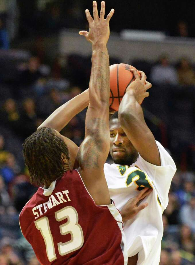 Siena's #3 Ryan Oliver tries to get past the defense of Rider's 13 Daniel Stewart, left, during the Metro Atlantic Athletic Conference opener at the Times Union Center in Albany Friday Dec. 7, 2012.  (John Carl D'Annibale / Times Union) Photo: John Carl D'Annibale / 00020381A