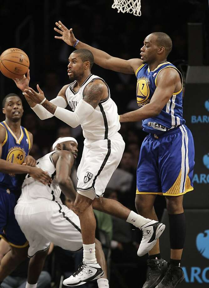 Brooklyn Nets guard C.J. Watson (1) passes as Golden State Warriors forward Carl Landry (7) in the second half of their NBA basketball game at the Barclays Center, Friday, Dec. 7, 2012, in New York. (AP Photo/Kathy Willens) Photo: Kathy Willens, Associated Press