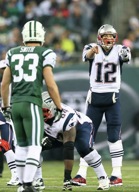 Tom Brady (12) has become the maestro that makes the Patriots' symphonic offense hum with a prolific precision. Photo: Elsa, Staff / 2012 Getty Images
