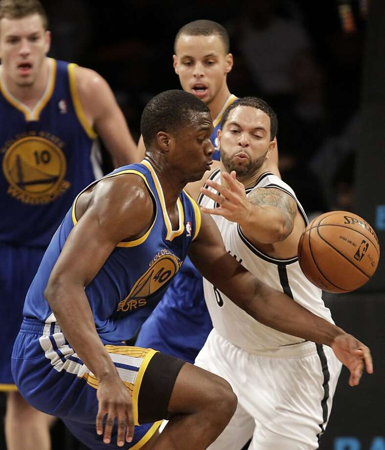 Brooklyn Nets guard Deron Williams (8) knocks the ball from Golden State Warriors forward Harrison Barnes (40) as Warriors forward David Lee (10) and Warriors guard Stephen Curry (30) watch during the second half of an NBA basketball game at the Barclays Center, Friday, Dec. 7, 2012, in New York. (AP Photo/Kathy Willens) Photo: Kathy Willens, Associated Press